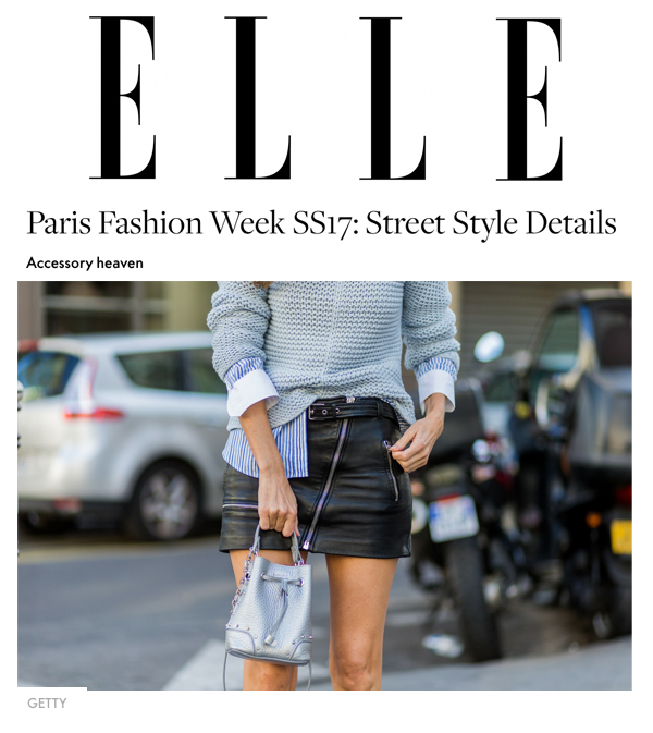 PARIS, FRANCE - OCTOBER : German model and fashion blogger Alexandra Lapp (@alexandralapp_) wearing a biker skirt in leather from Saint Laurent, striped shirt from Etro, knitwear from Oui, Les Specs sunglasses, 3.1 Phillip Lim shoes and Furla bag on October , 2016 in Paris, France. (Photo by Christian Vierig/Getty Images) *** Local Caption *** Alexandra Lapp on Elle