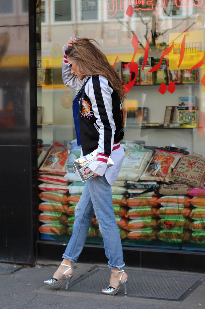 Alexandra Lapp wearing a bomber jacket from Topshop, Miu Miu, Louis Vuitton, Cutler and Cross, Celine, Levi's, Bernard Delettrez