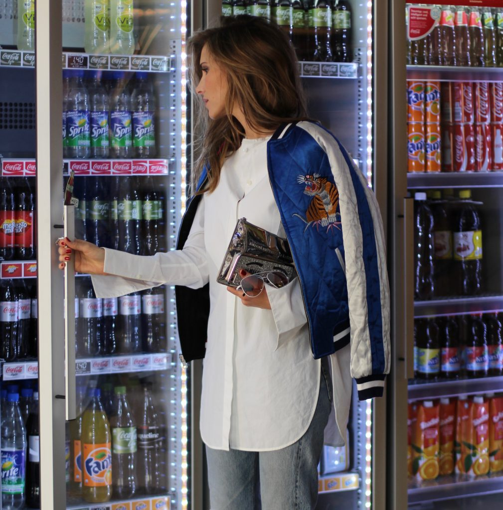 Alexandra Lapp wearing a bomber jacket from Topshop, Miu Miu, Louis Vuitton, Cutler and Cross, Celine, Levi's, Bernard Delettrez