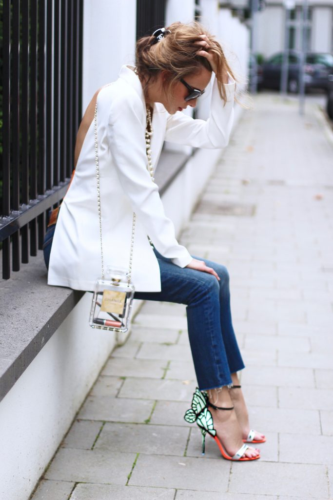 Alexandra Lapp wearing white pearls from Chanel, Levi's, Sophia Webster, Pearl and Rubies