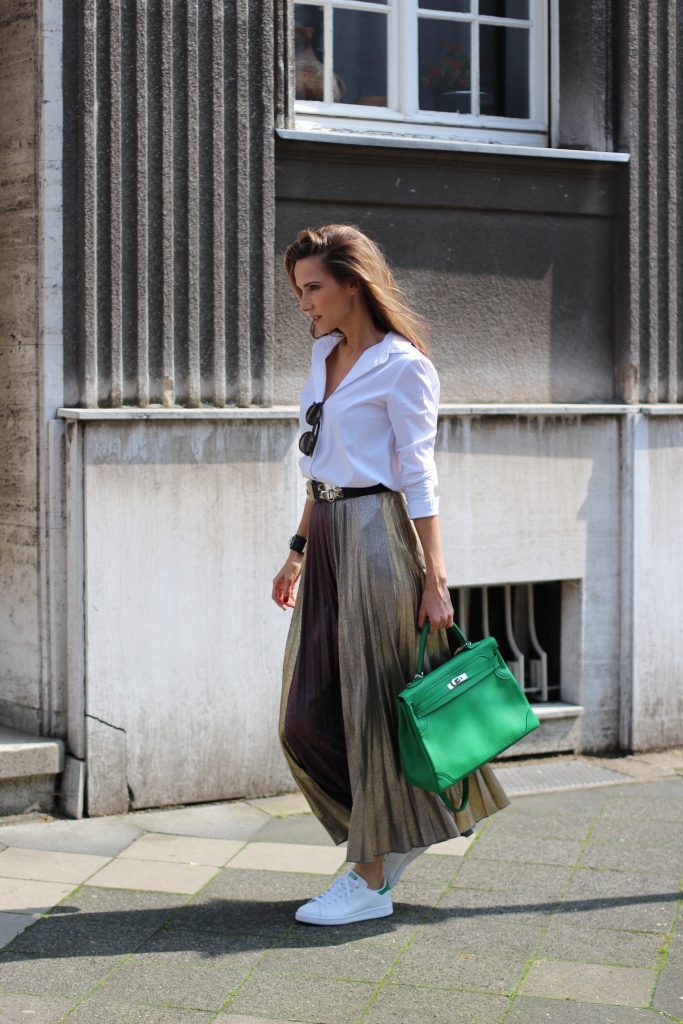 Alexandra Lapp wearing a pleated skirt from Max & Co., Adidas, Steffen Schraut, Hermès, Monokel Eyewear