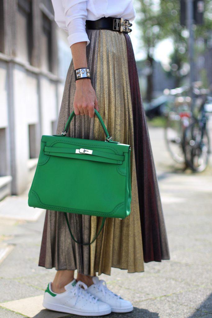 Alexandra Lapp wearing a pleated skirt from Max & Co., Adidas, Steffen Schraut, Hermès, Monokel Eyewear
