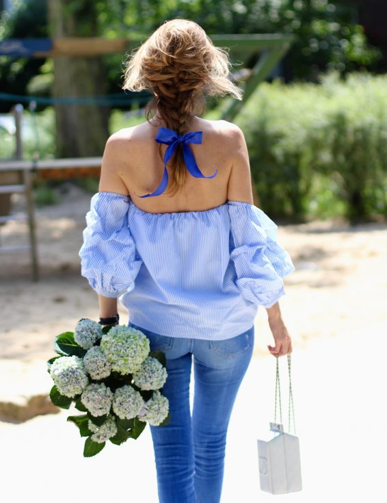 Alexandra Lapp wearing an off-the-shoulder blouse from Pixie Market, Chanel, Zara, IWC, Manolo Blahnik