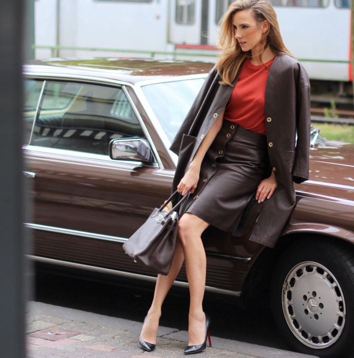 Alexandra Lapp wearing a leather two-piece-suit from Filippa K, Christian Louboutin, Hermès