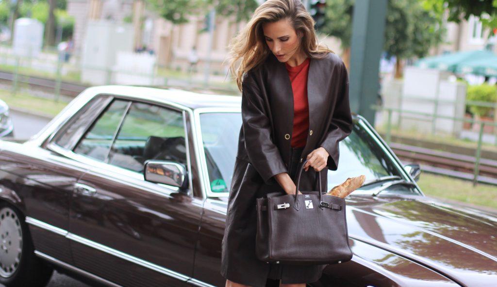 Alexandra Lapp wearing a leather two-piece-suit from Filippa K, Christian Louboutin, Hermès