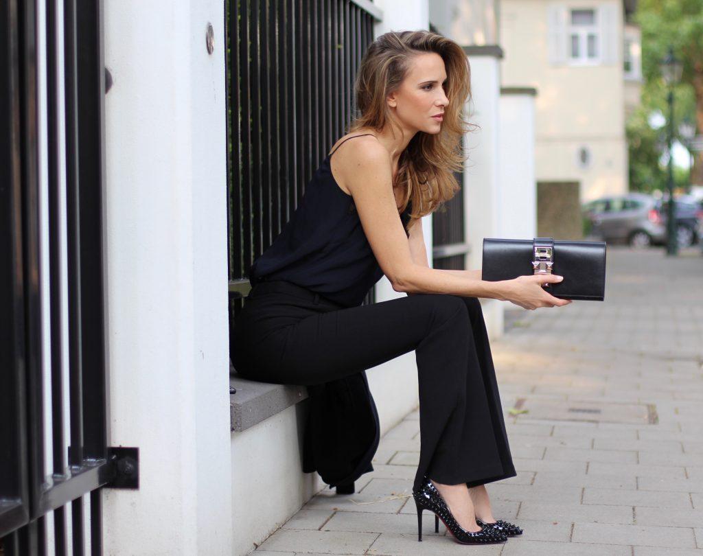 Alexandra Lapp wearing all black, Steffen Schraut, Filippa K., Hermès, Christian Louboutin, IWC