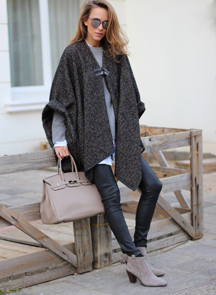 Alexandra Lapp wearing shades of grey, SET leather pants, Steffen Schraut cape and knitwear, Celine oversize shirt, Ash boots, Le Specs sunglasses and Hermès Birkin bag.