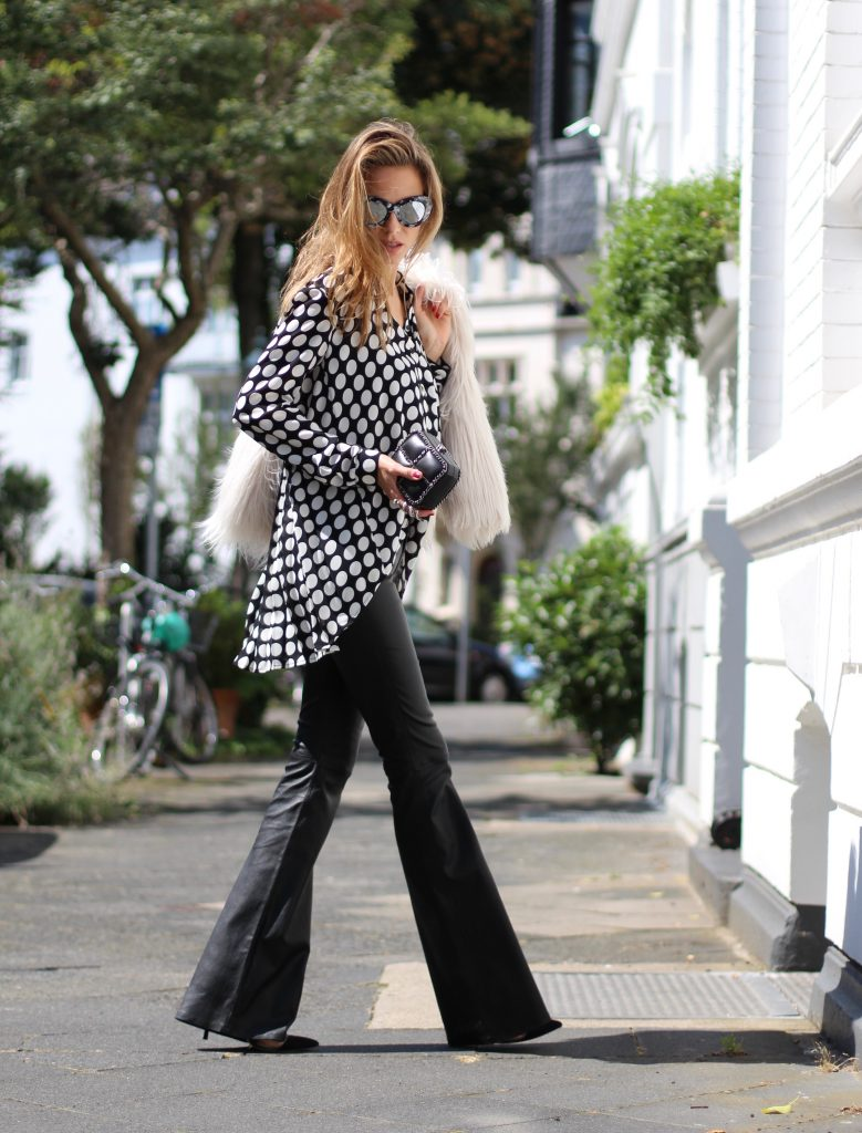 DÜSSELDORF; GERMANY - NOVEMBER : German model and fashion blogger Alexandra Lapp (@alexandralapp_) wearing Polka dots on a blouse from Steffen Schraut, flared leather pants from Tigha, faux fur from Steffen Schraut, Les Specs sunglasses, Gianvito Rossi shoes and Chanel bag on November, 2016 in Germany*** Local Caption *** Alexandra Lapp