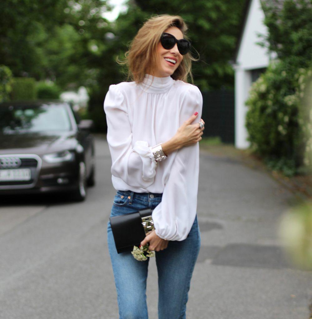 Alexandra Lapp wearing a tie neck blouse from Emilio Pucci, Levi's, Miu Miu, Céline, Hermès