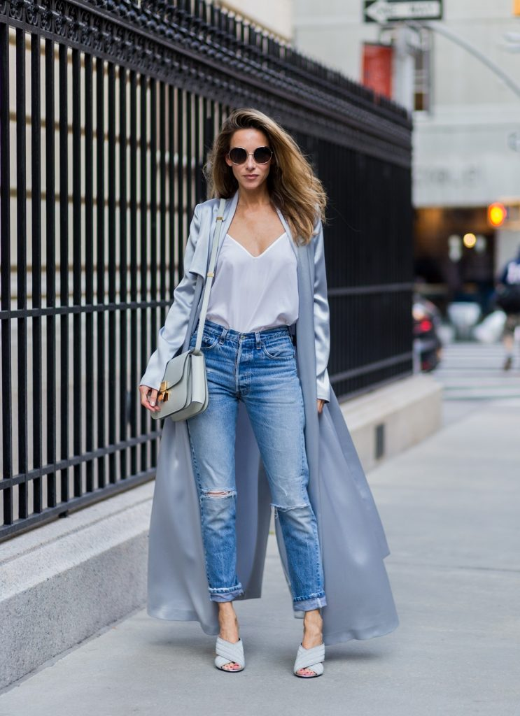 NEW YORK, NY - SEPTEMBER 13: German fashion blogger and model Alexandra Lapp (@alexandralapp_) grey silk trench coat from Galvan, Re Done Levis ripped denim jeans, Gucci mules, Celine bag, Chloe sunglasses on September 13, 2016 in New York City. (Photo by Christian Vierig/Getty Images) *** Local Caption *** Alexandra Lapp