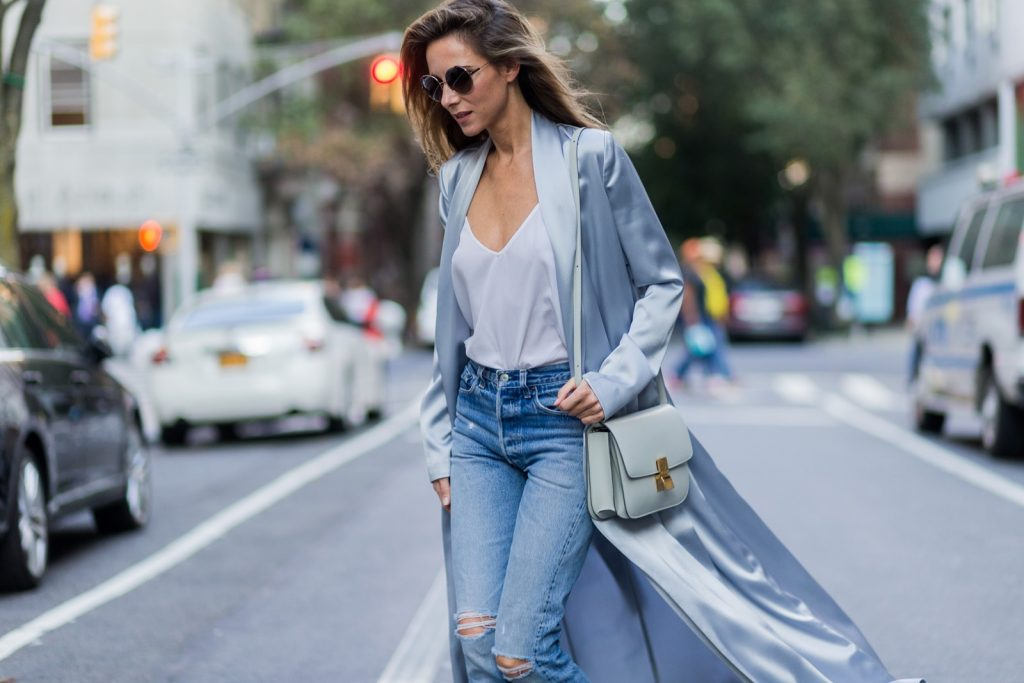 NEW YORK, NY - SEPTEMBER 13: German fashion blogger and model Alexandra Lapp (@alexandralapp_) grey silk trench coat from Galvan, Re Done Levis ripped denim jeans, Celine bag, Chloe sunglasses on September 13, 2016 in New York City. (Photo by Christian Vierig/Getty Images) *** Local Caption *** Alexandra Lapp