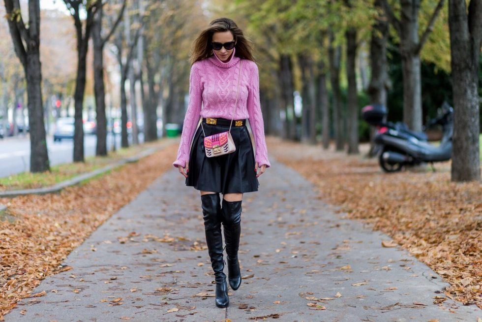 PARIS, FRANCE - OCTOBER 01: German model and fashion blogger Alexandra Lapp (@alexandralapp_) wearing a pink sweater from Jil Sander, leather pleated skirt from Steffen Schraut, overknees from Alaia, Celine sunglasses, Hermes belt, pink Furla bag on October 1, 2016 in Paris, France. (Photo by Christian Vierig/Getty Images) *** Local Caption *** Alexandra Lapp