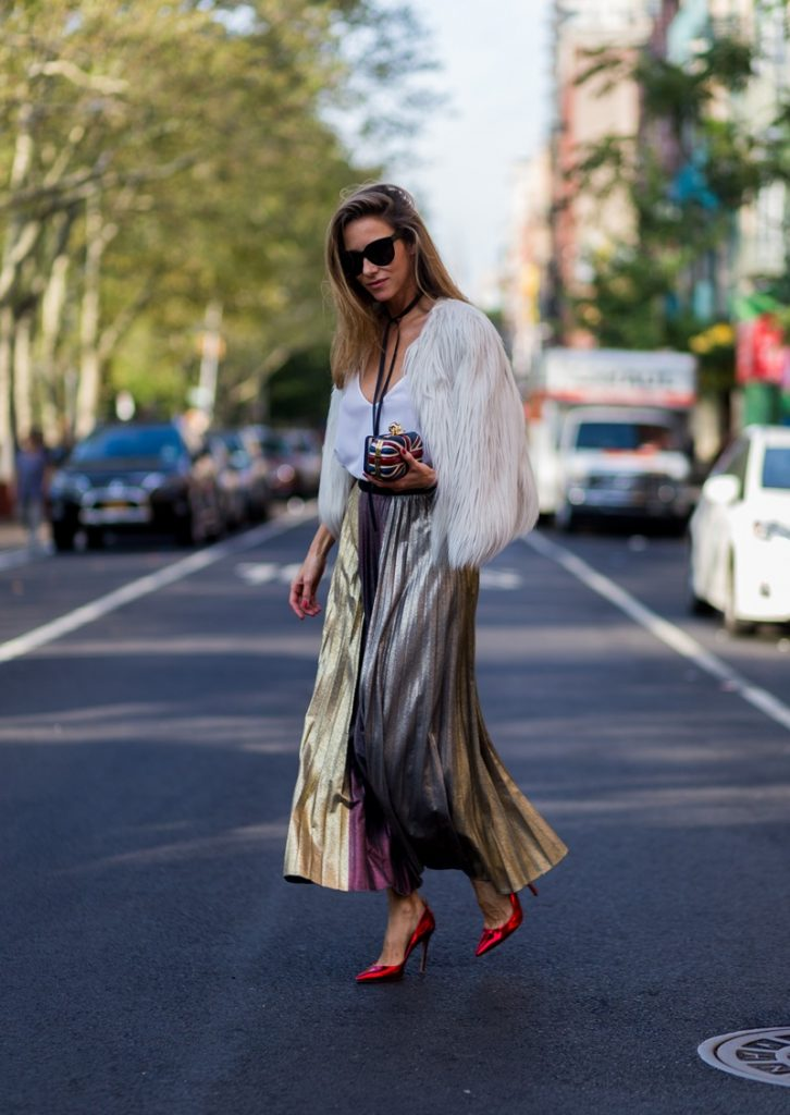 Alexandra Lapp wearing a metallic skirt by Max & Co., silk top by Jadicted, faux fur jacket by Steffen Schraut, pumps by Gianvito Rossi, clutch by Alexander McQueen, sunglasses by Céline in New York during NYFW.