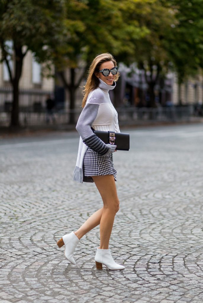 PARIS, FRANCE - OCTOBER 02: German fashion blogger and model Alexandra Lapp (@alexandralapp_) wearing knit wear from Prabal Gurung, skirt and boots from Zara, sunglasses by Le Specs and a clutch from Hermès on October 2, 2016 in Paris, France. (Photo by Christian Vierig/Getty Images) *** Local Caption *** Alexandra Lapp