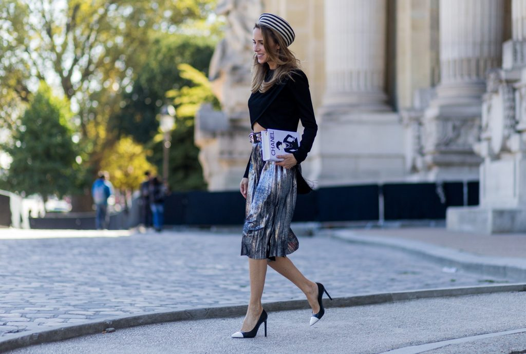 PARIS, FRANCE - OCTOBER 03: German fashion blogger and model Alexandra Lapp (@alexandralapp_) wearing Parisian Chic, a black sweater from Balmain, pleated skirt from Zara, Saint Laurent pumps, Gucci hat and selfmade bag with the print Chanel on October 3, 2016 in Paris, France. (Photo by Christian Vierig/Getty Images) *** Local Caption *** Alexandra Lapp