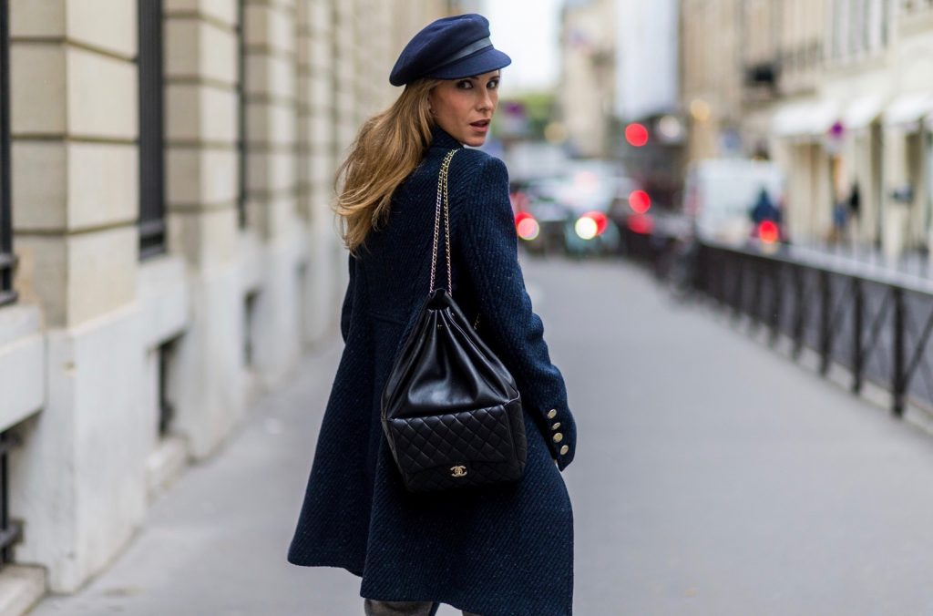 PARIS, FRANCE - SEPTEMBER 30: German fashion blogger and model Alexandra Lapp (@alexandralapp_) wearing Navy Coature, a blouse, grey pants, navy coat and hat from Marc Aurel, strap sandals from Balmain H&M and black Chanel backpack on September 30, 2016 in Paris, France. (Photo by Christian Vierig/Getty Images) *** Local Caption *** Alexandra Lapp
