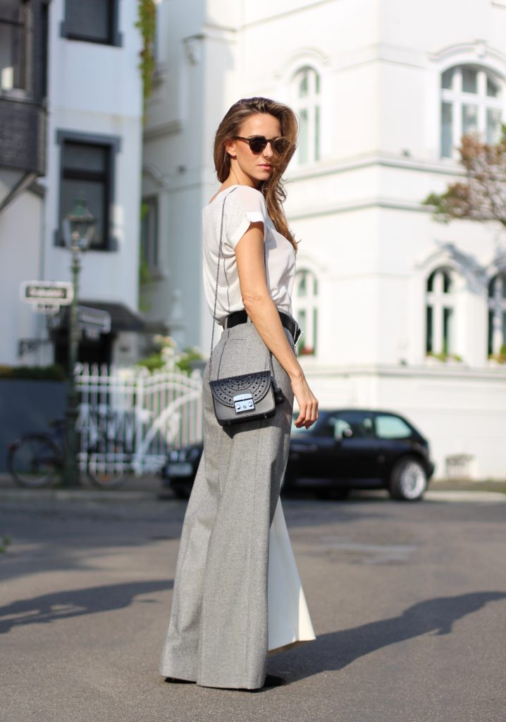 DÜSSELDORF; GERMANY - DEZEMBER : German model and fashion blogger Alexandra Lapp (@alexandralapp_) wearing Oui t-shirt, pants and wide leg pants, Monokel Eyewear sunglasses, Hermès belt, Tabitha Simmons shoes and Furla bag on Dezember, 2016 in Germany*** Local Caption *** Alexandra Lapp