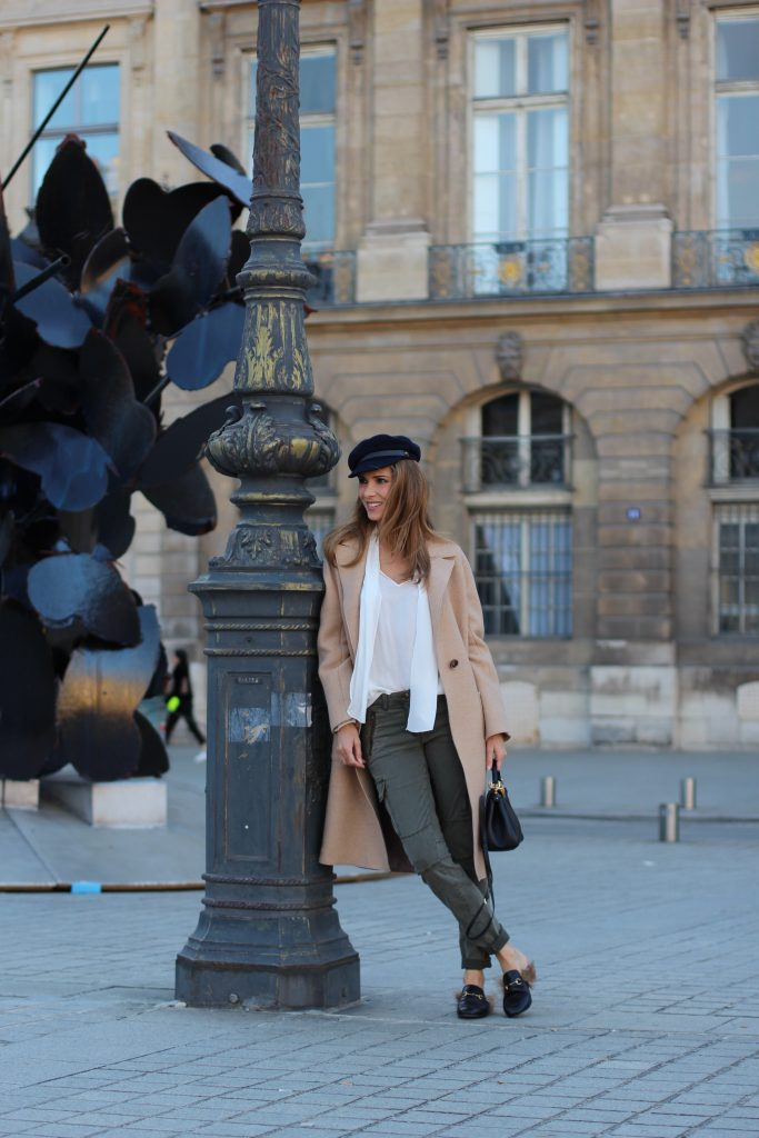 Place Vendôme, PARIS, FRANCE - NOVEMBER : German model and fashion blogger Alexandra Lapp (@alexandralapp_) wearing a camel coat, tie neck blouse and pants by Marc Aurel, princetown slippers from Gucci and peekaboo mini bag from Fendi, on November 2016 in Paris, France. *** Local Caption *** Alexandra Lapp