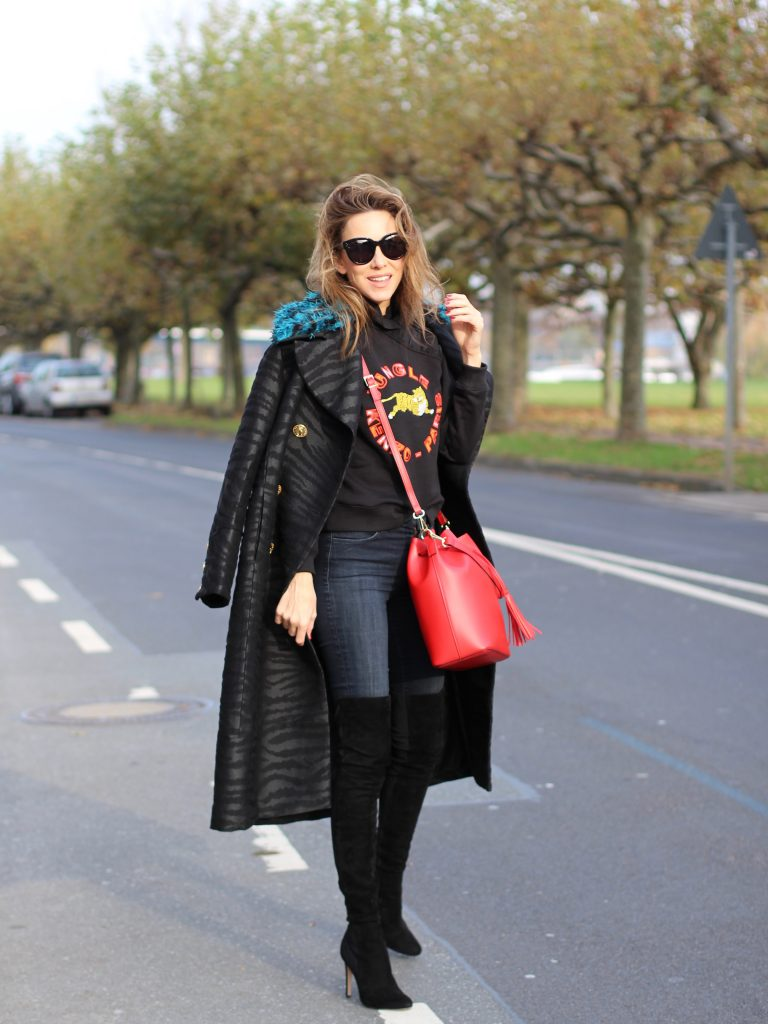 DÜSSELDORF; GERMANY - DEZEMBER : German model and fashion blogger Alexandra Lapp (@alexandralapp_) wearing Kenzo x H&M sweater and coat Céline sunglasses, Gianvito Rossi overknees and Camelia Roma bag on Dezember, 2016 in Germany*** Local Caption *** Alexandra Lapp