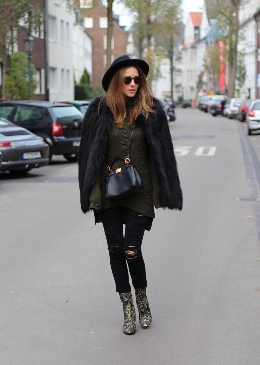 DÜSSELDORF; GERMANY - DEZEMBER : German model and fashion blogger Alexandra Lapp (@alexandralapp_) wearing brocade booties by Ash, destroyed denim pants from Frame, Celine turtleneck, Prada fur jacket, Dorfman Pacific hat, Monokel eyewear and a Fendi bag on Dezember, 2016 in Germany*** Local Caption *** Alexandra Lapp
