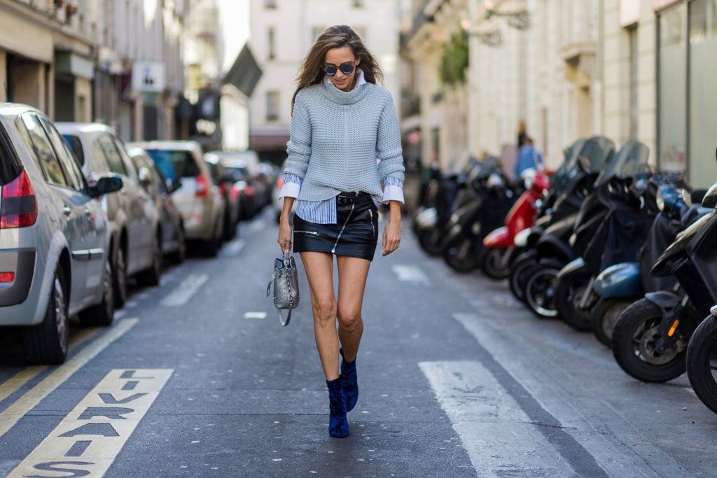 PARIS, FRANCE - OCTOBER : German model and fashion blogger Alexandra Lapp (@alexandralapp_) wearing a biker skirt in leather from Saint Laurent, striped shirt from Etro, knitwear from Oui, Les Specs sunglasses, 3.1 Phillip Lim shoes and Furla bag on October , 2016 in Paris, France. (Photo by Christian Vierig/Getty Images) *** Local Caption *** Alexandra Lapp