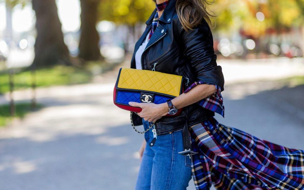 PARIS, FRANCE - OCTOBER 03: German fashion blogger and model Alexandra Lapp (@alexandralapp_) wearing layer love, Levis denim jeans, a white James Perse tshirt, L'Agence plaid dress, white Zara shoes, Ray Ban sunglasses, Schott NYC leather jacket, Chanel bag on October 3, 2016 in Paris, France. (Photo by Christian Vierig/Getty Images) *** Local Caption *** Alexandra Lapp