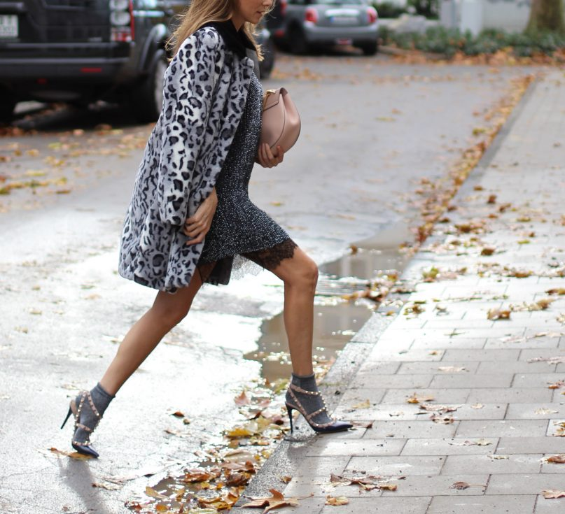 DÜSSELDORF; GERMANY - DEZEMBER : German model and fashion blogger Alexandra Lapp (@alexandralapp_) wearing glitter socks by Forever 21, glitter dress from Marciano Guess, neglige from Agent Provocateur, faux fur, fake fur from Patricia Pepe, rockstud pumps by Valentino and a Chloe bag on Dezember, 2016 in Germany*** Local Caption *** Alexandra Lapp