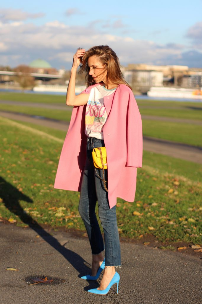DÜSSELDORF; GERMANY - DEZEMBER : German model and fashion blogger Alexandra Lapp (@alexandralapp_) wearing a Coco Cuba T-shirt from Chanel, high waist denim from Levi's, cashmere coat from Prada, rockstud pumps by Gianvito Rossi and a yellow GG Marmont Mini bag by Gucci on Dezember, 2016 in Germany*** Local Caption *** Alexandra Lapp