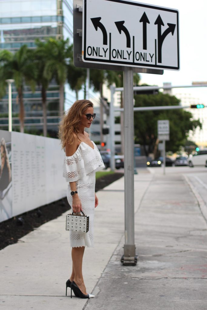 MIAMI; FLORIDA - JANUARY : German model and fashion blogger Alexandra Lapp (@alexandralapp_) wearing a MCM Berlin crossbody bag in black and white, Isla off the shoulder dress in white, Saint Laurent pumps, an IWC watch and cat eye sunglasses by Prada on January, 2017 in Miami *** Local Caption *** Alexandra Lapp