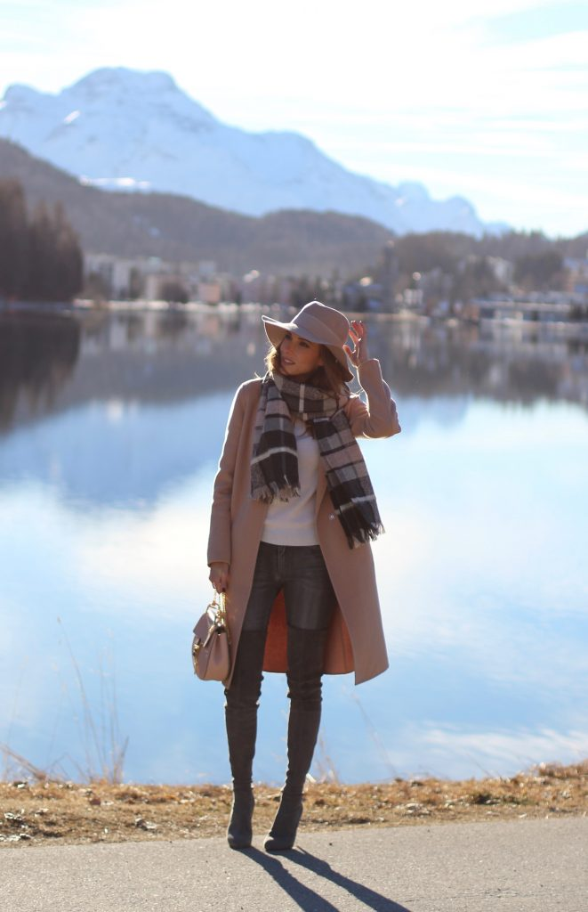 SANKT MORITZ - DEZEMBER : German model and fashion blogger Alexandra Lapp (@alexandralapp_) wearing Marc Cain in St. Moritz, an off white turtleneck, grey slim jeans, a beige cashmere coat, scarf and hat by Marc Cain, overknee boots in grey from Gianvito Rossi, IWC watch and a bag by Chloe on Dezember, 2016 in Sankt Moritz *** Local Caption *** Alexandra Lapp