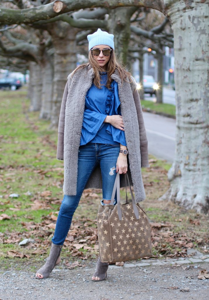 DÜSSELDORF; GERMANY - DEZEMBER : German model and fashion blogger Alexandra Lapp (@alexandralapp_) wearing denim on denim, a denim blouse from Storets, denim by Adriano Goldschmied, velvet booties by Halston, a baby blue beanie from Marc Cain, sunglasses by Le Specs, coat and bag by Steffen Schraut on Dezember, 2016 in Germany*** Local Caption *** Alexandra Lapp
