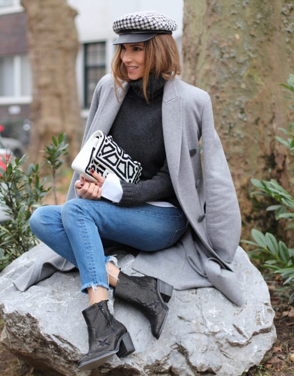 DÜSSELDORF; GERMANY - JANUARY : German model and fashion blogger Alexandra Lapp (@alexandralapp_) wearing western boots from Nubikk, high waist denim from Levi's, a white shirt and a grey cashmere coat by Céline, black and white bag from Chanel, hat from Eugenia Kim and cashmere knitwear by Loro Piana on January, 2017 in Germany*** Local Caption *** Alexandra Lapp