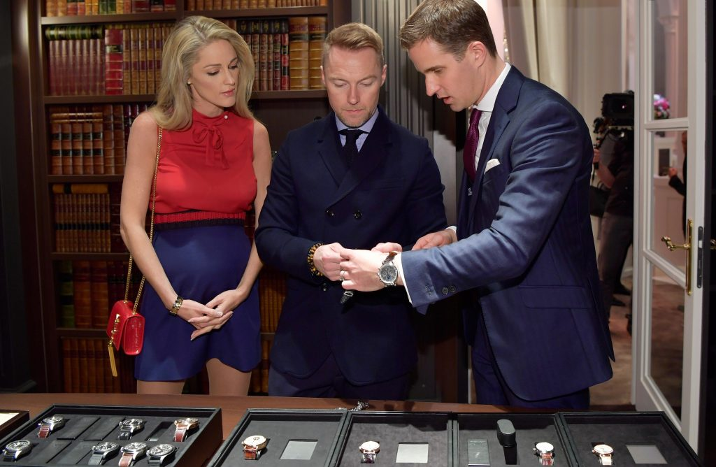 GENEVA, SWITZERLAND - JANUARY 17: Storm and Ronan Keating with Christoph Grainger-Herr at the IWC booth during the launch of the Da Vinci Novelties from the Swiss luxury watch manufacturer IWC Schaffhausen at the Salon International de la Haute Horlogerie (SIHH) 2017 on January 17, 2017 in Geneva, . (Photo by Harold Cunningham/Getty Images for IWC) *** Local Caption *** Storm Keating; Ronan Keating; Christoph Grainger-Herr