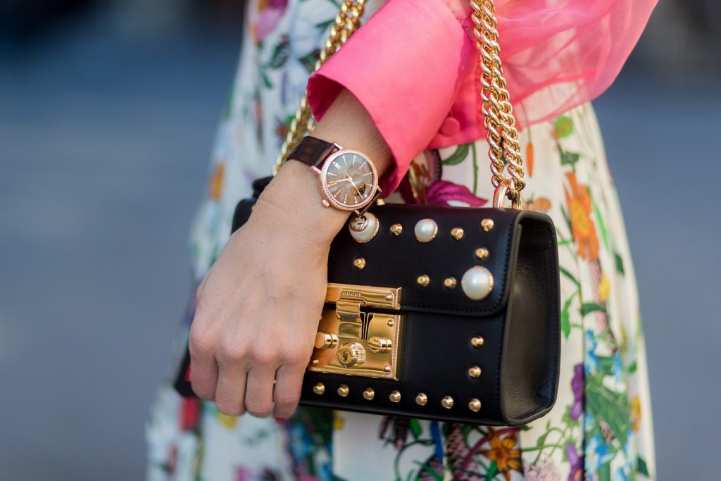 FLORENCE, ITALY - JANUARY 11: German fashion blogger and model Alexandra Lapp is wearing a black Padlock shoulder bag by Gucci , a pink blouse by Gucci, pleated Flora snake, silk skirt by Gucci on January 11, 2017 in Florence, Italy. (Photo by Christian Vierig/Getty Images) *** Local Caption *** Alexandra Lapp