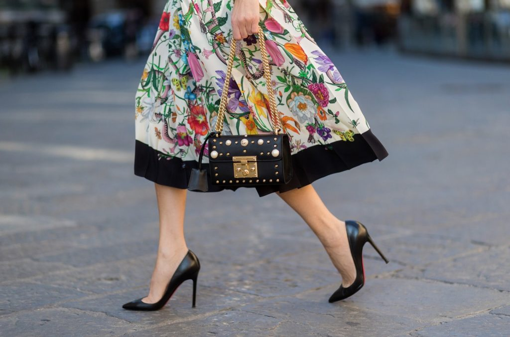 FLORENCE, ITALY - JANUARY 11: German fashion blogger and model Alexandra Lapp is wearing a black Padlock shoulder bag by Gucci , a pink blouse by Gucci, pleated Flora snake, silk skirt by Gucci, sunglasses from Celine, black Christian Louboutin pumps on January 11, 2017 in Florence, Italy. (Photo by Christian Vierig/Getty Images) *** Local Caption *** Alexandra Lapp