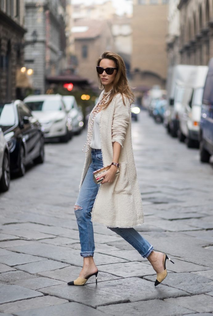 FLORENCE, ITALY - JANUARY 11: German fashion blogger and model Alexandra Lapp, wearing a Levi's RE/DONE jeans, a tank top by Jadicted, a white, classic coat from Oui Fashion, white pearls and sunglasses with pearls from Chanel and Chanel mules and clutch on January 11, 2017 in Florence, Italy. (Photo by Christian Vierig/Getty Images) *** Local Caption *** Alexandra Lapp