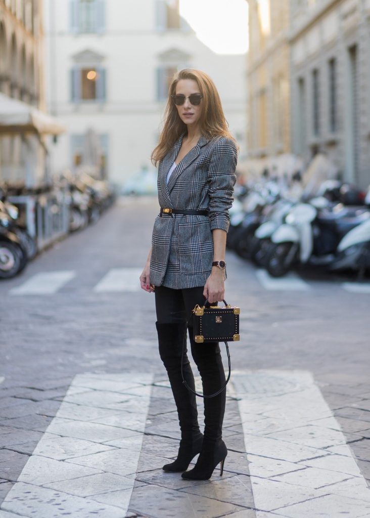 FLORENCE, ITALY - JANUARY 11: German fashion blogger and model Alexandra Lapp is wearing leather pants from Set, suede overknee boots in black by Gianvito Rossi, off white silk top from Jadicted, straight-cut, double-breasted jacket in woven fabric with two front pockets and a double back vent from H&M, Hermes women's leather belt in black Epsom calfskin, Kelly buckle in palladium plated gold metal, bag MCM small Berlin Crossbody, Ray-Ban Clubmaster sunglasses on January 11, 2017 in Florence, Italy. (Photo by Christian Vierig/Getty Images) *** Local Caption *** Alexandra Lapp