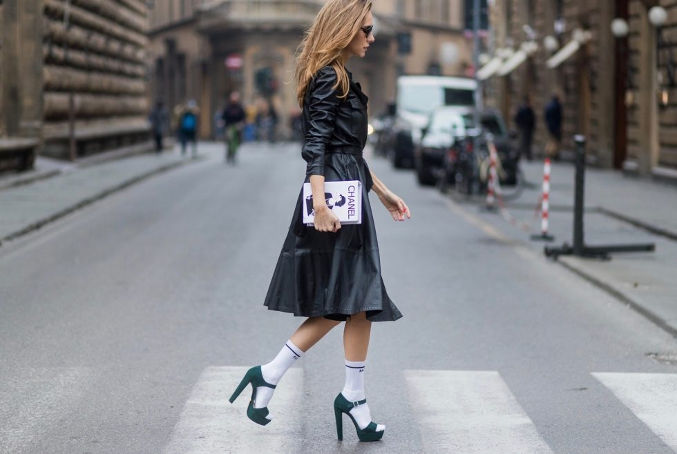 FLORENCE, ITALY - JANUARY 11: German fashion blogger and model Alexandra Lapp, wearing a leather shirt dress from Set Fashion, white tennis socks with printed Mother Fucker, dark green plateau sandals from Prada, Matte black 'Dior So Real' sunglasses from Dior Eyewear and a handmade book clutch from MD Clutch on January 11, 2017 in Florence, Italy. (Photo by Christian Vierig/Getty Images) *** Local Caption *** Alexandra Lapp