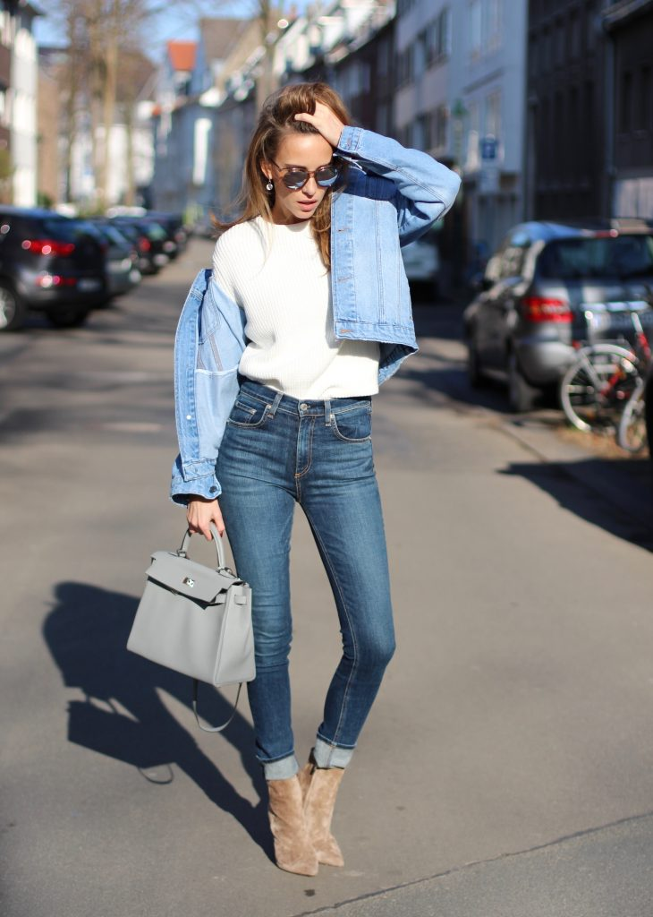 DÜSSELDORF, GERMANY - FEBRUARY 14: German fashion blogger and model Alexandra Lapp is wearing double denim - a light blue denim jacket by SET, slim fit high waist denim from Rag and Bone, off white knitwear from Oui, Hermes Kelly bag in light grey, Le Specs sunglasses, beige velvet booties from Gianvito Rossi and a light beige wool coat from Steffen Schraut on February 14, 2017 Düsseldorf, Germany. *** Local Caption *** Alexandra Lapp