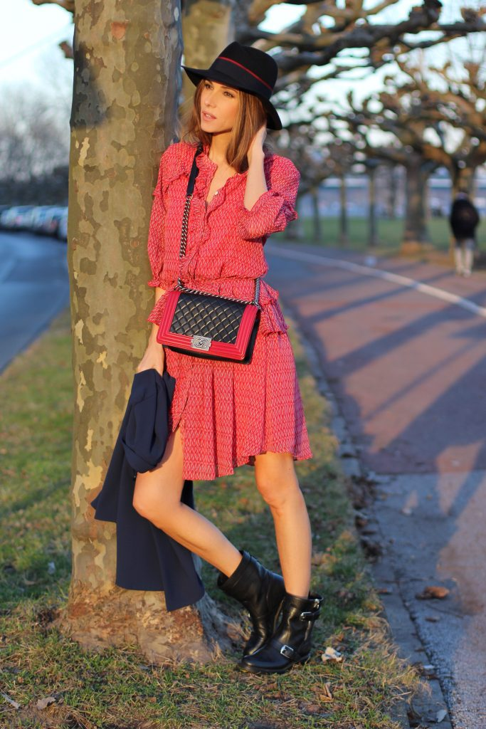 DÜSSELDORF, GERMANY - FEBRUARY 19: German fashion blogger and model Alexandra Lapp is wearing a flounce dress in red from Steffen Schraut, a midnight blue blazer by Steffen Schraut, Maison Michel Virginie rabbit-felt fedora hat in black with a grosgrain ribbon in dark blue with red, that is adorned with the label's logo in the form of a glossy black charm, a boy bag in black and red calfskin and vintage biker boots by Gucci on February 19, 2017 Düsseldorf, Germany. *** Local Caption *** Alexandra Lapp