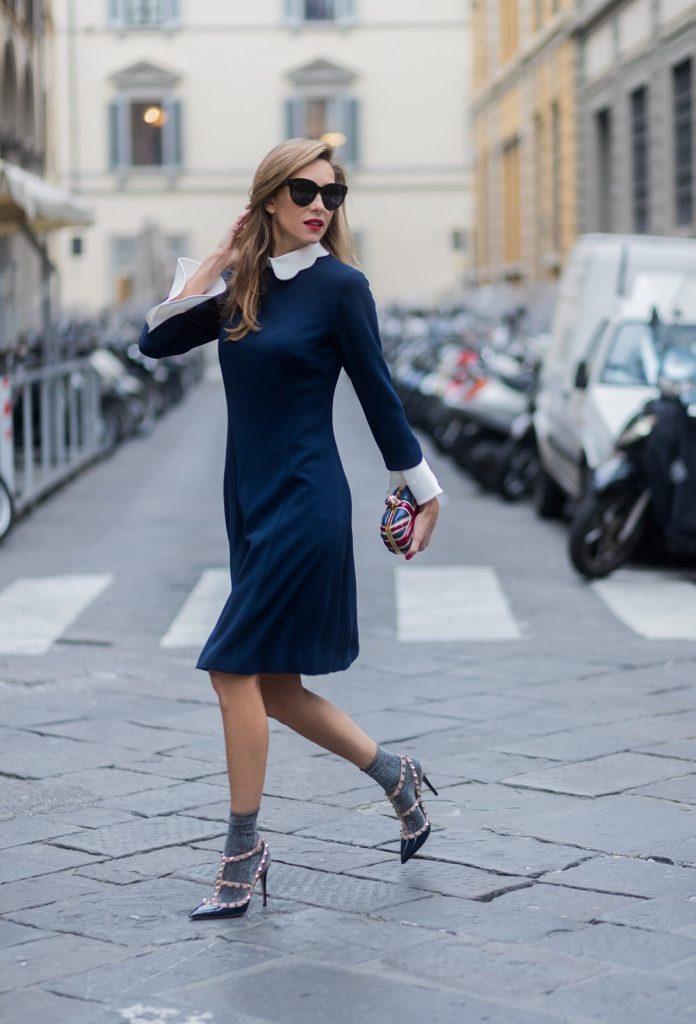 FLORENCE, ITALY - JANUARY 11: German fashion blogger and model Alexandra Lapp, wearing a navy blue knee-length shirt dress in flared cut with removable wavy Peter Pan collar and white cuffs by Steffen Schraut, glitter socks from TK Maxx, Valentino Garavani Rockstud ankle strap pump in dark blue with patent leather and platinum finish studs and a Alexander McQueen's 'Britannia' box clutch which is emblazoned with the Union Jack and which is topped with the brand's signature Swarovski crystal-embellished skull clasp on January 11, 2017 in Florence, Italy. (Photo by Christian Vierig/Getty Images) *** Local Caption *** Alexandra Lapp