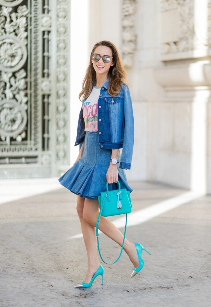 PARIS; FRANCE; during PFW, Blogger and Model Alexandra Lapp wearing a Statement shirt, a colorful graphic T-Shirt from Chanel Cuba Cruise 2017 collection, A-line denim skirt from Balmain, trucker denim Jacket from Levis, two tone pumps in oasis green with a silver toe cap in 10cm from Manolo Blahnik, Bag MCM Milla bag, Sunglasses by Les Specs on March 3, 2017 in Paris, France.