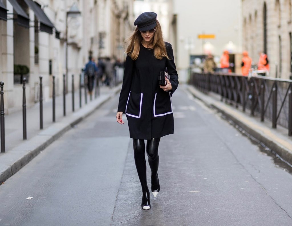 PARIS; FRANCE; RUE CAMBON; Model and Blogger Alexandra Lapp wearing black Couture Latex socks from Atsuko Kudo, coat from Steffen Schraut, Pumps by Saint Laurent, Cap from Chanel, Chanel Lego Brique (brick) bag in black and white, Sunglasses by Chromehearts on March 3, 2017 in Paris, France.