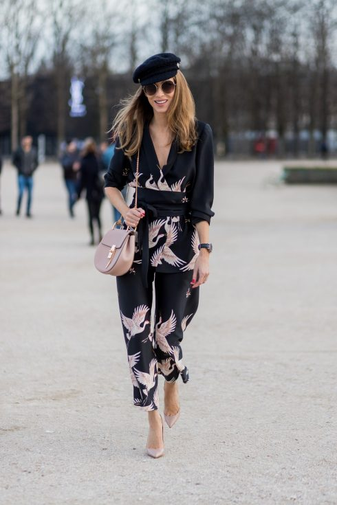 PARIS; FRANCE; during PFW, Model and Blogger Alexandra Lapp wearing Sleepwear to Daywear, Printed jacket with contrasting sash belt, lapel collar and long sleeves from Zara in black with rose birds, Matching flowing printed culottes from Zara in black with rose birds, Christian Louboutin nude lacquer pumps, nude Drew small leather cross-body bag by Chloe, Cap from Chanel, Sunglasses by Chloe on March 3, 2017 in Paris, France.