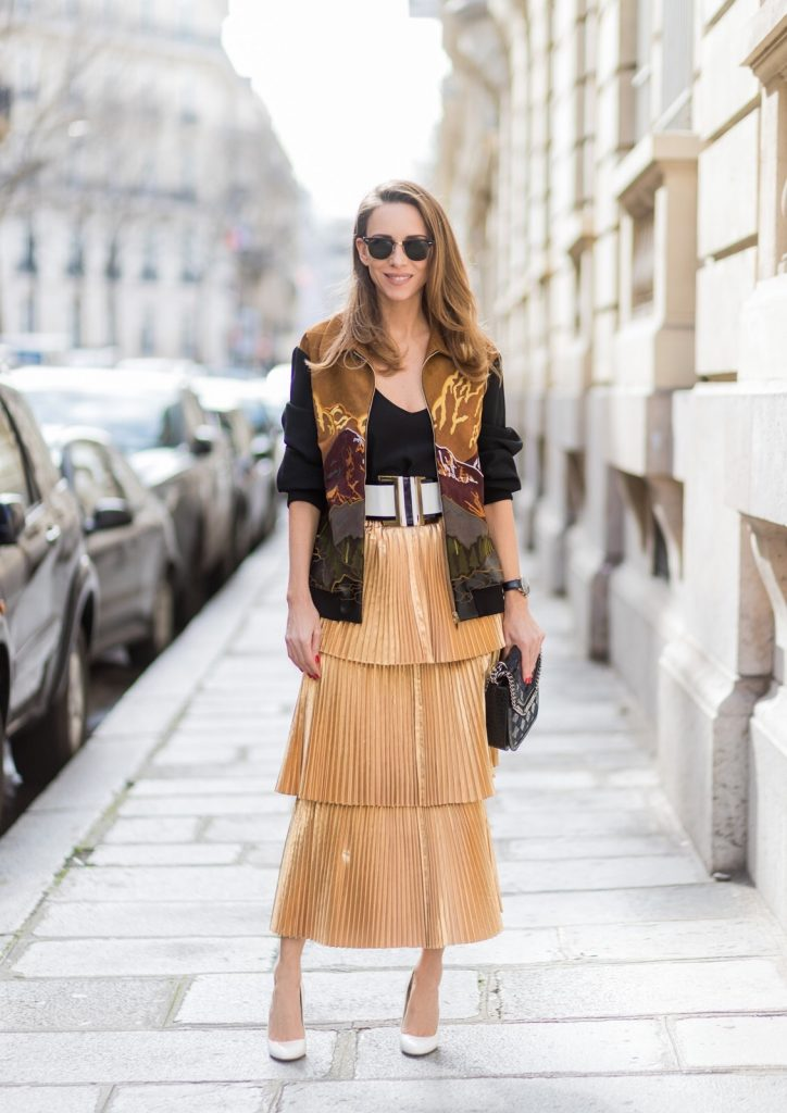 PARIS;FRANCE during PFW, Model and Blogger Alexandra Lapp wearing a pleated skirt & bomber jacket from Stella McCartney, skirt named Melody skirt, Stella McCartney blue Falabella box mini shoulder bag, black silk Tank top from Jadicted, white lacquer pumps by Prada, RayBan clubmaster sunglasses, waist belt in black and white by Balmain on March 3, 2017 in Paris, France.