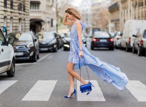 PARIS; FRANCE; Model and Blogger Alexandra Lapp wearing a striped shirt dress, a long dress made of stripe stretch seersucker in greek blue and white from Talbot Runhof, blue plexi pumps from Gianvito Rossi and a blue Boy bag from Chanel on March 3, 2017 in Paris, France.