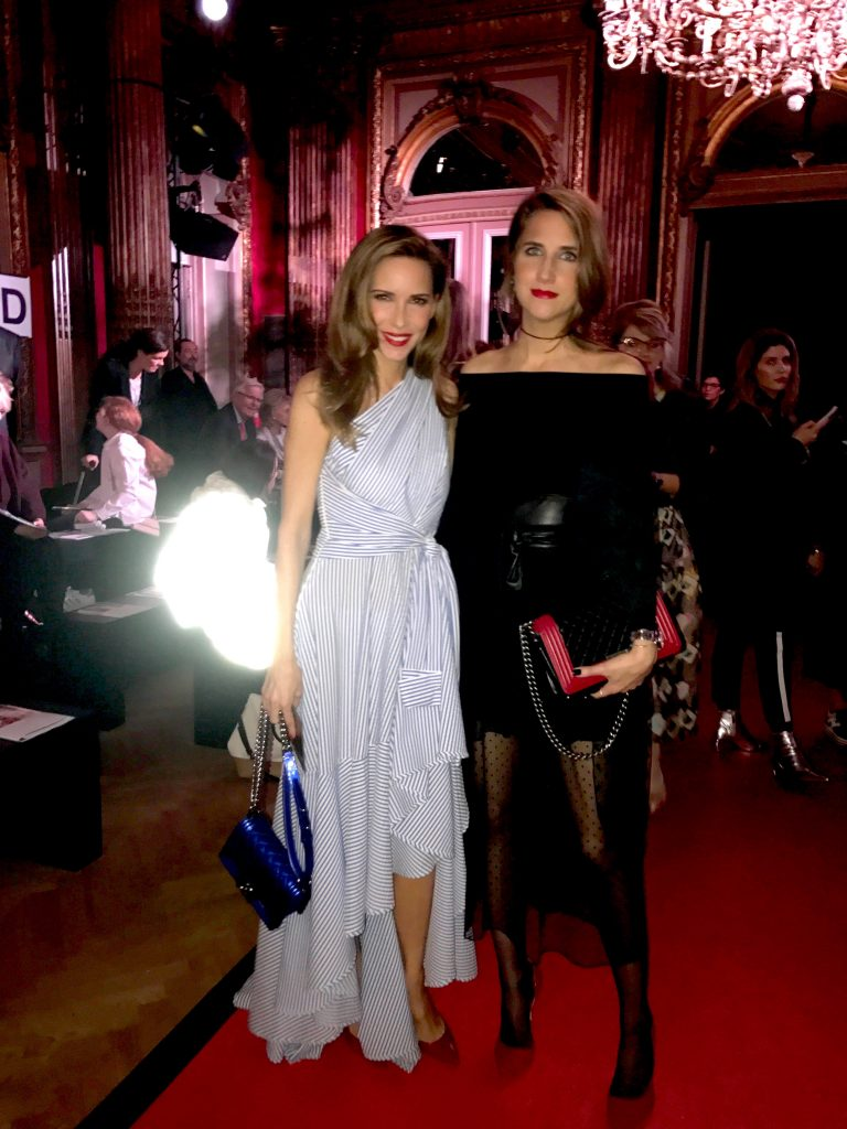 PARIS; FRANCE; Model and Blogger Alexandra Lapp and her sister Isabel Lapp during Talbot Runhof Show in Paris, is wearing a striped shirt dress, a long dress made of stripe stretch seersucker in greek blue and white from Talbot Runhof, blue plexi pumps from Gianvito Rossi and a blue Boy bag from Chanel on March 4, 2017 in Paris, France.
