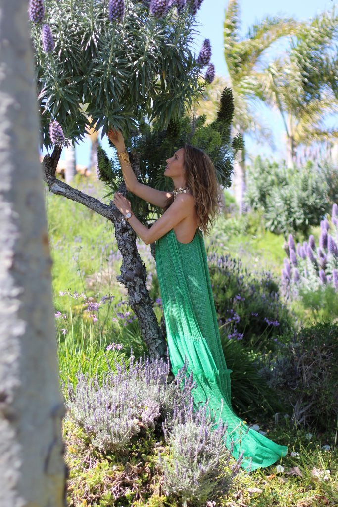 Los Angeles, MALIBU, April 2017, Model and Blogger Alexandra Lapp wearing Art Youth Society AYS jewelry, a green long JOY dress by Stella McCartney, bracelets from GAS Bijoux, a coin belt around the neck worn like a necklace and a IWC Da Vinci watch in red gold with diamonds in Malibu, Los Angeles, April 2017.