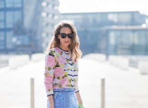 Happy Easter; Model and fashion blogger Alexandra Lapp wearing a sequin skirt by Ashish, stole / shawl and pullover made of cashmere from Heartbreaker, black sunglasses from Celine, neon pink So Kate' pumps by Christian Louboutin and a clutch bag in white with MCM monogram in black, detailed with a drawing of a funky punk rabbit on March 30, 2017 in Duesseldorf, Germany.