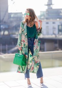Model and fashion blogger Alexandra Lapp has a Kimono Love, wearing a green flower printed kimono from Zara, a green tank top in silk, blue jeans from Vetements in cooperation with Levi´s with cut-out raw hems, white snake pumps from Christian Louboutin, Ray Ban Aviator sunglasses in green and a Hermes Kelly Ghillies 35 bag in green bamboo on March 30, 2017 in Duesseldorf, Germany.